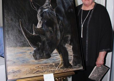 Artist Carol Cox with her beautiful painting
